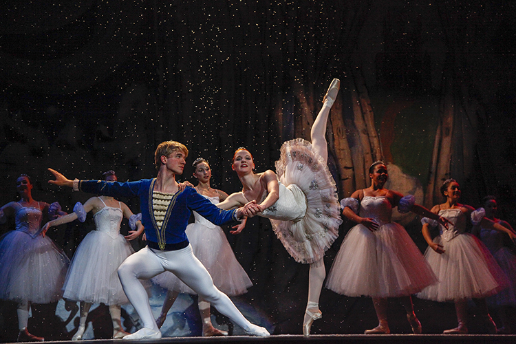 Wendy Langton and Ian Zeisel as the Snow Fairy and her Cavalier pose and snow drifts down around the dancers.