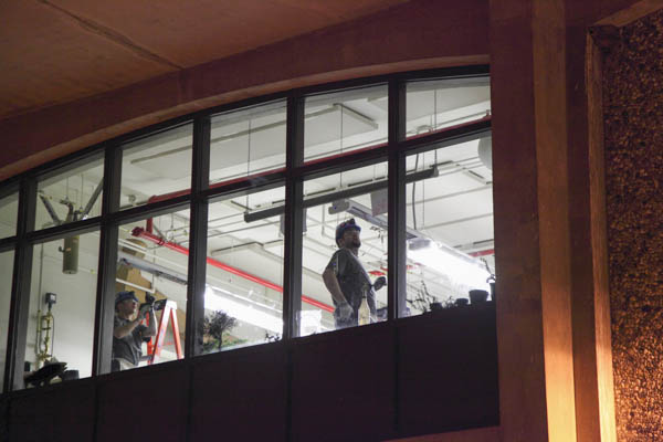 Changing lightbulbs at night in UAF's metal smithing room.