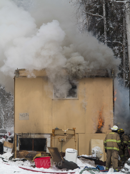 Firefighters battle flames from a mobile home April 30, 2013.
