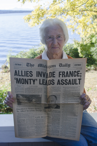 Claire Thomas holds a copy of The Michigan Daily from June 6, 1944. She was editor of the paper during the D-Day invasion of Europe.