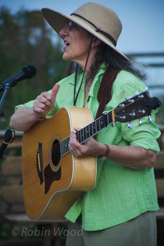 Susan Grace taps her guitar and sings, June 27, 2013.