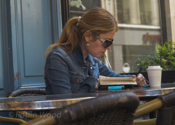 Intently writing and smoking in Paris.