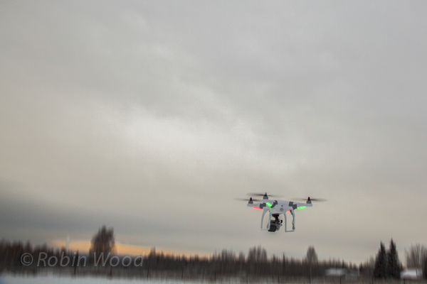 A colorful drone takes off amid a gray day, Nov. 9, 2013.