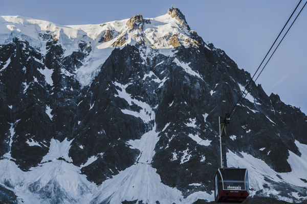 The Aguille de Midi cable car quickly becomes obscured by the mountain it will soon summit.