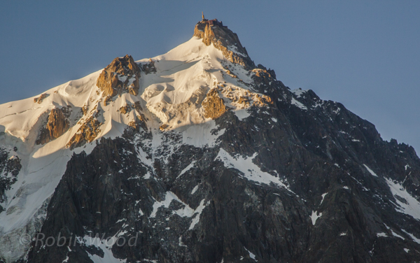 Closeup of Aiguille du Midi, a viewing platform  and communications tower high in the Alps.