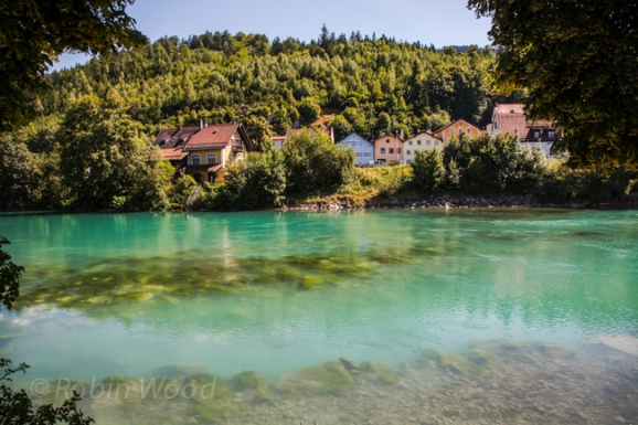 Houses situated along a vibrant green river in the town of Fussen, Bavaria.
