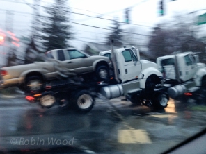 Truck towing a truck with a truck on the bed. Not pictured: a truck towing all three.