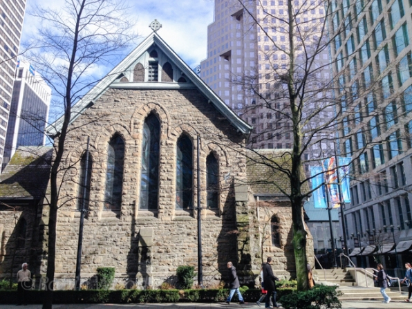 Church backdropped by skyscrapers in downtown Vancouver, Canada.