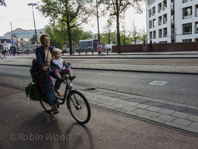 Kids on bikes in precarious positions are commonplace in Amsterdam.
