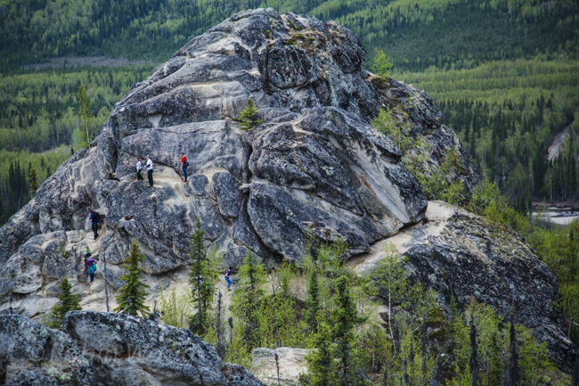 Hikers climb and play on one of the many formations at Angle Rocks. May 17, 2014.