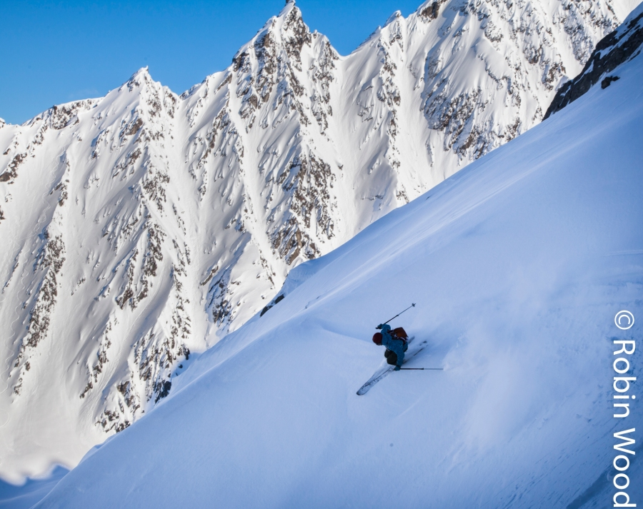 Mt. Diamond backdrops Eli Sturm as he skies down a couloir on Thompson Pass. The scenery and snow are world class.