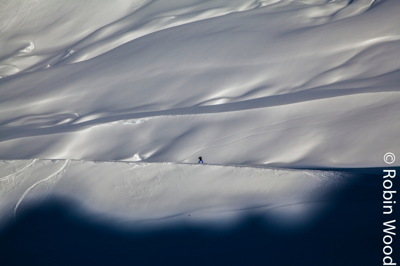 A skier traverses towards shade on the Diamond Glacier in Thompson Pass.