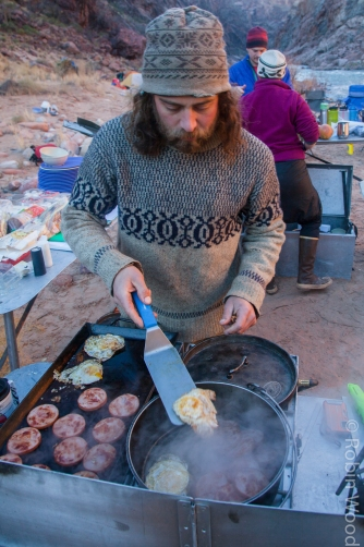 Co-captain Ben Allen cooks breakfast in the Grand Canyon.